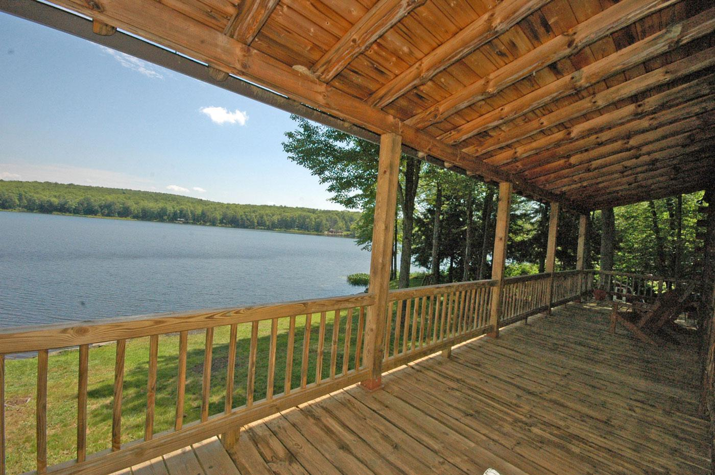 Custom log home on private lake front for sale by owner for Lake front view